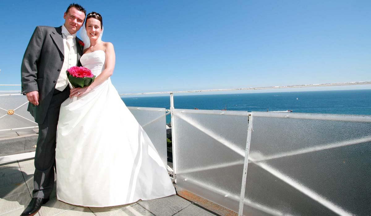 Bride and Groom aganist a bright blue sky